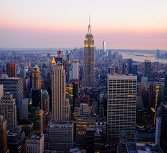 Evening Sunset in New York City (` Toshio ') Tags: city nyc newyorkcity sunset newyork buildings island manhattan rockefellercenter midtown eastriver empirestatebuilding statueofliberty topoftherock toshio freedomtower 1worldtradecenter xe2 oneworldtradecenter oneworldcenter fujixe2