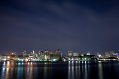 Boston Wisp (sleepwalkmaster) Tags: city longexposure urban reflection water boston skyline night buildings lights evening bay twilight dusk citylights midnight