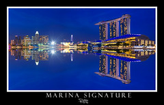 Marina Signature (Ashley Teo (PilotPotato)) Tags: blue sunset urban panorama water architecture marina buildings reflections landscape lights evening bay singapore long exposure glow cityscape slow dusk magic wide dramatic scene architectural hour shutter epic blending d7000