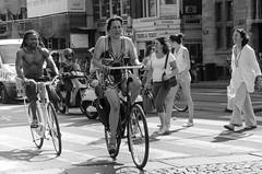 manhunt (105mm) Tags: street people woman sun girl dutch amsterdam bike bicycle women shoes legs candid style streetlife mini skirt blond fiets streetwear mensen manhunt streetstyle