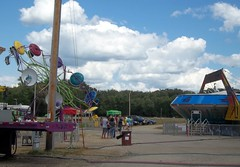 A&P Paratrooper And Gravitron Rides. (dccradio) Tags: carnival trees sky motion tree wisconsin clouds fun action bluesky fair ufo aliens pole greenlake entertainment ap greenery rides wisdom midway tron countyfair dropzone utilitypole powerpole wi amusements gravitron starship thrillride carnivalrides paratrooper amusementride communityevent fairrides mechanicalrides apshows apenterpriseshows apcarnival wisdomrides wisdomindustries wisdommanufacturing greenlakecountyfair