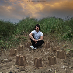 Untitled (CatherineMacgeorge) Tags: boy sunset portrait colour beach grass youth square sand nikon child bright dune innocent young memory sandcastle sanddune protection protect 2013