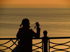 Painting With Light (alexinatempa) Tags: sunset england silhouette person somerset railing seafront clevedon