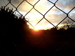 Morning, Majorca (Muggeridge Photography) Tags: sunset orange sun yellow clouds fence wire seeing through rise majorca obstruct 2013