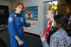 "Sandy_in_FlightSuit_with_two_Students • <a style=""font-size:0.8em;"" href=""http://www.flickr.com/photos/90600314@N08/11407936135/"" target=""_blank"">View on Flickr</a>"