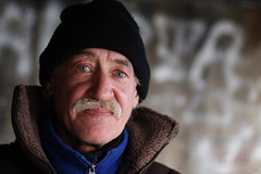 Never look back (Vt Hassan) Tags: blue portrait man never men face look graffiti back eyes europe prague homeless moustache czechrepublic