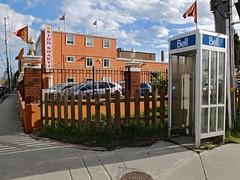 Orange Bell (geowelch) Tags: toronto etobicoke telephonebooth urbanlandscape hindutemple urbanfragments fujifilmx10
