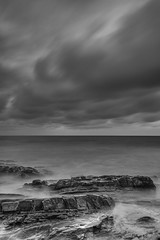 Laguna Beach - Building Storm (www.karltonhuberphotography.com) Tags: longexposure sky blackandwhite bw seascape monochrome weather clouds moody pacificocean southerncalifornia drama unrest tension graysky lagunabeach stormclouds californiacoastline restless grayday 2016 flowingwater verticalimage shorelinerocks karltonhuber