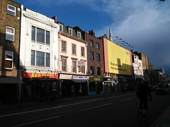 buildings on east side of kingsland road n1, looking south, just before shoreditch high street,  2016-04-26, 18-31-51 (tributory) Tags: road street city light sunset shadow urban sunlight black london cars lines weather walking grey spring cyclist traffic angle outdoor pavement side pedestrian bluesky inner vehicles hoxton hackney flaneur