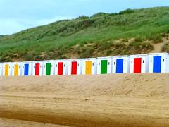 beach huts (Jackal1) Tags: travel blue red england green beach yellow sand colours dunes huts devon beachhuts sanddunes woolacombe