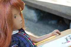 Daydreaming (Emily1957) Tags: sashadolls sashadoll redhair daydreaming school schoolgirl dolls doll toys toy writer writing light naturallight nikond40 kitlens pencil sasharedheadwhitedress 1979 tampaprintbrowneyes
