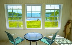 A New England View (Jamie McCaffrey) Tags: windows vacation usa hotel spring fuji waterfront unitedstates maine scenic newengland atlantic fujifilm oceanview rockport emptychairs xt1 islandviewinn