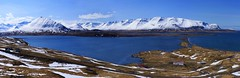 a Northern fjord, a causeway and a coastal lagoon (lunaryuna) Tags: panorama seascape season landscape coast iceland spring shoreline fjord lunaryuna causeway mountainrange snowcappedmountains northatlantic northiceland seasonalchange coastallagoon