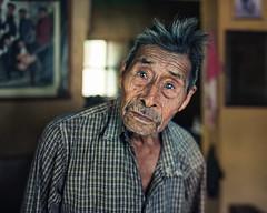 Juan, 92 years old, San Lucas Tolisman, Guatemala (Benoit.P) Tags: portrait color art 35mm print weed bokeh guatemala smoke fineart stranger 8x10 older marijuana 92 sanlucas overlanding