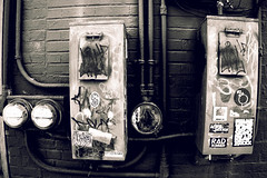 Disconnected (mheidelberger2000) Tags: indianapolis fountainsquare city urban southside blackandwhite gritty electricity electrical meter disconnect power conduit brick old graffiti sticker alleyway pipe electric electricmeter dirty midwest