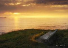 Banco al atardecer. Getxo (Mimadeo) Tags: ocean sunset sea sun beach stone sunrise bench coast solitude shoreline lonely getxo abscense