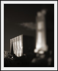 tower (Andrew C Wallace) Tags: city distortion blur building tower sepia architecture lensbaby ir australia melbourne victoria infrared cbd tiltshift m43 720nm nikon50mmf14 microfourthirds tilttransformer olympusomdem5