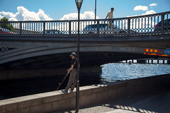 Fishing & Chill (Florian Btow) Tags: city travel bridge summer sun water lamp architecture clouds river walking fishing sweden stockholm pole