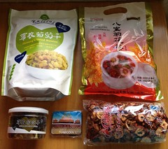 Goodies from China. Dried raisins, chrysanthemum and longan teas, and a souvenir fridge magnet from Beijing, the forbidden city. (Travel Galleries) Tags: china city food fridge tea herbs chinese beijing raisins forbidden souvenir snacks organic dried goodies magnet chrysanthemum herbal longan uploaded:by=flickrmobile flickriosapp:filter=nofilter