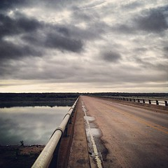 Sky time at my bridge (bethbikes33) Tags: bridge sky reflection clouds landscape vanishingpoint sierra lux southend leadinglines huemore iphoneography squaready lampassasriverbridge