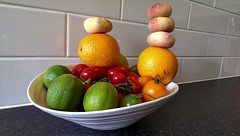 fruitship (r0sejam) Tags: food kitchen fruit tomatoes bowl tiles peaches oranges limes