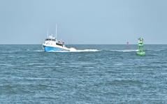 Pelican (Ray Horwath) Tags: gulfofmexico boat nikon texas pelican porta fishingboat tamron portaransas gulfcoast shipchannel texasgulfcoast mustangisland horwath tamronlens coastalbend d700 commercialboat rayhorwath tamron28mm300mmlens
