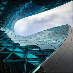 Emporia Blue (Maerten Prins) Tags: longexposure blue windows sky distortion color colour reflection green glass clouds mall sweden turqouise shoppingcentre line emporia tiles sverige curve malm malmo zweden upshot ndfilter