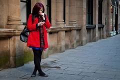 Nail Biting Message (Leanne Boulton) Tags: life street city red portrait people urban woman color colour building mobile wall composition standing scarf canon scotland colorful technology message phone cross bright pavement glasgow candid coat text nail perspective pedestrian scene biting line diagonal sidewalk smart