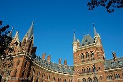 The refurbished St Pancras International Railway Station and Midland Grand Hotel Kings Cross London UK (Roberto Herrett) Tags: new city uk railroad travel blue red england sky orange building travelling london english tourism station k horizontal architecture speed buildings outside high construction holidays view eurostar unitedkingdom britain decorative bricks capital transport sightseeing victorian cities rail railway places trains facades front tourist architectural historic international u transportation link historical classical british traveling renovation ornate accommodation vacations luxury development terminals sights imposing attractions locations stockphoto renovated luxurious terminus exteriors channeltunnel redevelopment destinations midlandgrandhotel stpancrasstation rherrettflk