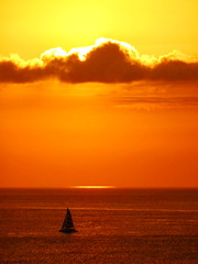 Golden spotlight on the horizon (peggyhr) Tags: ocean sunset sky orange nature silhouette yellow clouds sailboat wow spotlight thegalaxy 50faves peggyhr thegalaxyhalloffame thelooklevel1red thelooklevel2yellow ♣mother thegalaxystars dsc05254a