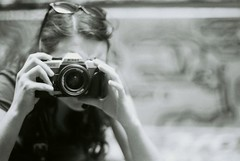 Me, circa 2007 (Katie Tarpey) Tags: portrait blackandwhite bw film 35mm blackwhite bokeh depthoffield nikonfm10