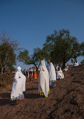 Ethiopian women walking along a hill, Amhara region, Lalibela, Ethiopia (Eric Lafforgue) Tags: africa people color tree vertical walking religious outdoors clothing day african traditional faith hill religion scenic christian unescoworldheritagesite daytime christianity shawl spirituality ethiopia hillside orthodox groupofpeople adultsonly coptic developingcountry traditionalculture lalibela hornofafrica ethiopian eastafrica äthiopien etiopia abyssinia ethiopie traditionalclothing realpeople etiopía menwomen fulllenght エチオピア traveldestination etiopija africanethnicity ethiopië 埃塞俄比亚 africanculture etiopien etiópia 埃塞俄比亞 etiyopya אתיופיה amhararegion эфиопия 에티오피아 αιθιοπία 이디오피아 種族 етиопија 衣索匹亚 衣索匹亞 semienwollozone ethio161462