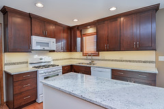 stained-kitchen-cabinets-tile-backsplash-remodel-remodeling-home-granite-sebring-services (sebringservices) Tags: white home kitchen stained granite remodel luxury cabinets remodeling hardwood
