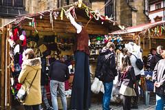 how's going (ian.latte) Tags: leica people man shop 50mm prague outdoor candid sightseeing stall tourist praskhrad souvenir czechrepublic tall greeting stilts leicam