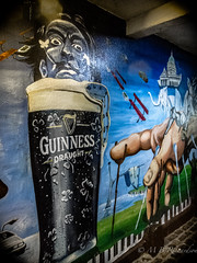 Belfast city graffiti (Sasquatchpics) Tags: graffiti drink belfast guinness cloister salvadordali nireland canons95
