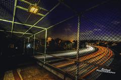 Dark Corners (KurteeQue) Tags: california nightphotography architecture dark oakland nikon highway nightshot outdoor eerie freeway bayarea lightstreaks 580 grandtheatre
