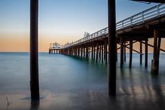 Pier exposure 2 (eddygdk) Tags: california travel sunset sun beach water sunrise pier los sand long exposure glow angeles malibu