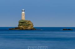 Andros Lighthouse (vangeliskakavas) Tags: longexposure greece andros tourlitis lighthouse sea seascape landscape rocks waves sky blue