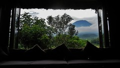 window with a view (SM Tham) Tags: trees bali mountain window glass clouds reflections indonesia island volcano restaurant asia view interior silhouettes peak sofa thatchedroof cushions eaves windowseat mountagung karangasem gunungagung amlapura baliasli