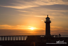 Whitby pier sunrise (MichikoSmith) Tags: uk morning sea summer england sky orange sun lighthouse sunshine clouds sunrise harbor pier town seaside purple harbour yorkshire north whitby