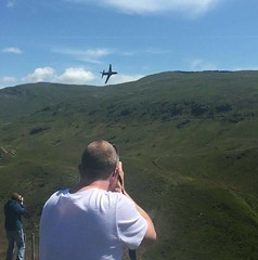 Getting the shot.... (phil_dutton) Tags: sky mountain plane airplane flying low jet valley flyby