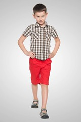 Fashion little boy walks (khanov2007) Tags: boy portrait people white cute smile childhood studio fun happy person one stand kid european alone child little walk joy young handsome indoor front single positive cheerful enjoyment pleasure isolated confident caucasian positivity