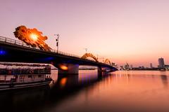 The Nam 019 (Cycle the Ghost Round) Tags: city sunset urban orange reflection water river evening view symbol dusk landmark vietnam danang hanriver dragonbridge caurong