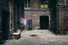Apartment for workers. (Tomasz Aulich) Tags: door old city windows urban sunlight house building brick wall architecture town workers nikon apartment poland clothes wash d redcolour
