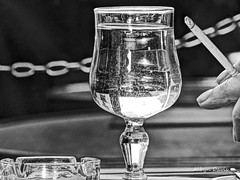 le petit dejeuner (albyn.davis) Tags: paris cafe blackandwhite cigarette smoking water glass ashtray outdoor france europe street reflection