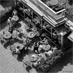 High tea (John Riper) Tags: street people bw white black netherlands monochrome stairs canon reflections john square photography mono restaurant high rotterdam sitting tea zwartwit terrace candid l engels 6d 24105 groot groothandelsgebouw straatfotografie handelsgebouw riper johnriper