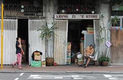 Leung Hei Kee Store (MonsieurOchon) Tags: china park old shirtless hk news reading newspaper store phone chinese pedestrian hong kong hongkongpark leungheikee