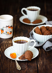 Coffee madeleines with apricot confiture (Julicious) Tags: wood food orange cup coffee dark table dessert baking yummy cookie sweet rustic spoon fresh textile homemade jar apricot madeleine jam confiture foodphoto cacao foodphotography foodstyle