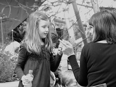 And Don't Eat It All At Once! (Fire*Sprite*75) Tags: street blackandwhite food woman girl monochrome lady photography child daughter mother strangers scene