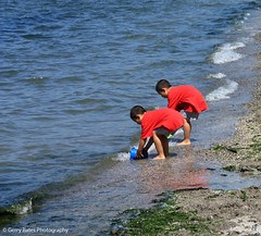 Beach Play 2 (gerry.bates) Tags: sea summer people shells canada seaweed beach boys water kids vancouver canon children sand waves play bc britishcolumbia shore inlet burrardinlet kitsilanobeach flickr10
